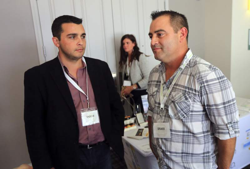 CBD founder and operator Dennis Hunter, right, with VP Nick Caston at the Cultivating Community conference. PD File