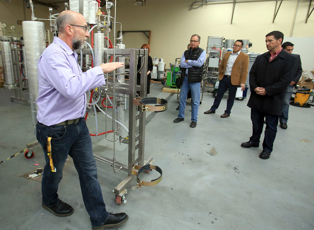 Greg Galardy of CBD Guild explains how a C02 fluid extraction machines produce cannabis concentrates, Wednesday Dec. 14, 2016 in Santa Rosa. (Kent Porter / The Press Democrat) 2016 Kent Porte