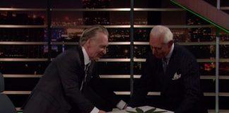 Roger Stone presents a marijuana cake to Bill Maher.