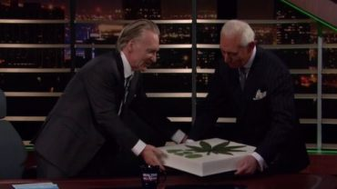 Roger Stone presents a marijuana cake to Bill Maher.