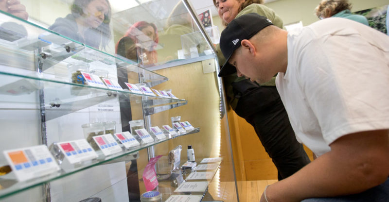 Customers shop for a variety of cannabis products on the first day legal recreational marijuana in Sonoma County at SPARC/Peace in Medicine in Sebastopol on Monday morning, January 1, 2018. (photo by John Burgess/The Press Democrat)